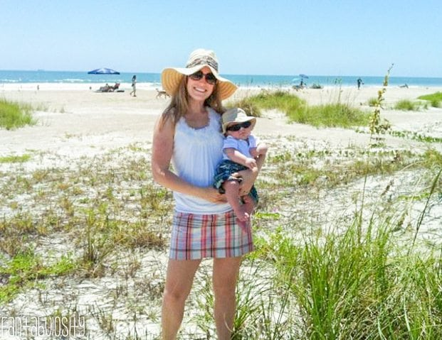 Baby on the beach with mom and sunhat in Cocoa Beach Florida