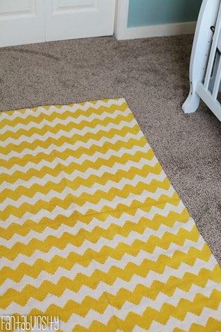 Baby Girl Nursery Gray and Coral Design Yellow Chevron Rug https://fantabulosity.com