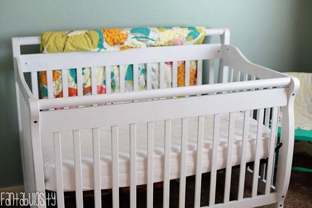 Baby Girl Nursery Gray and Coral Design White Crib https://fantabulosity.com