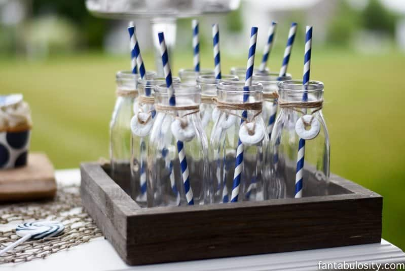 Nautical Birthday Party Ideas, milk bottles with lifesaver candy wrapped around them! So cute! https://fantabulosity.com