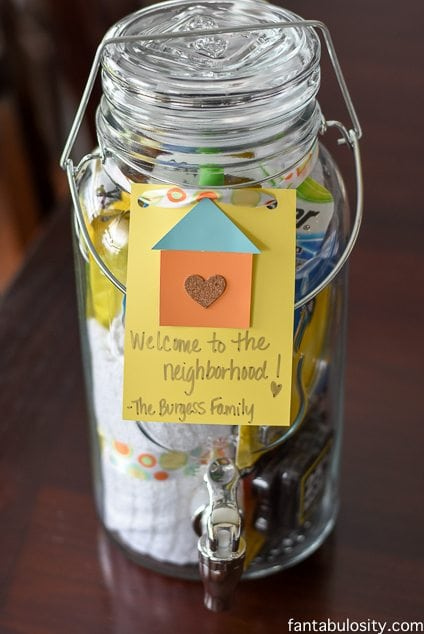 "DIY Housewarming Gift Ideas. Mason Jar Drink dispenser with all of those ""always need,"" items when moving in! Awesome! https://fantabulosity.com"