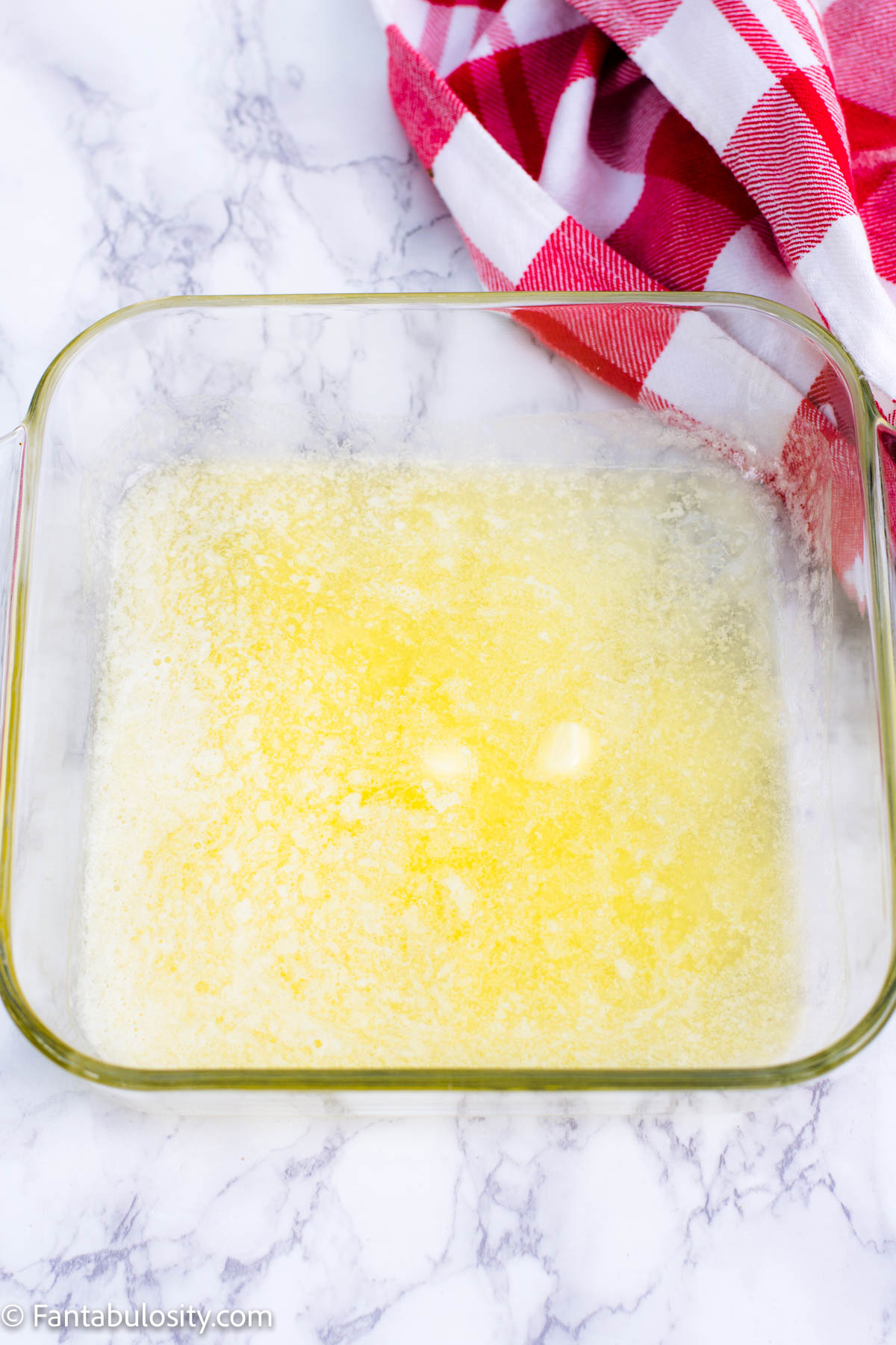 Melt butter in 8x8 baking dish
