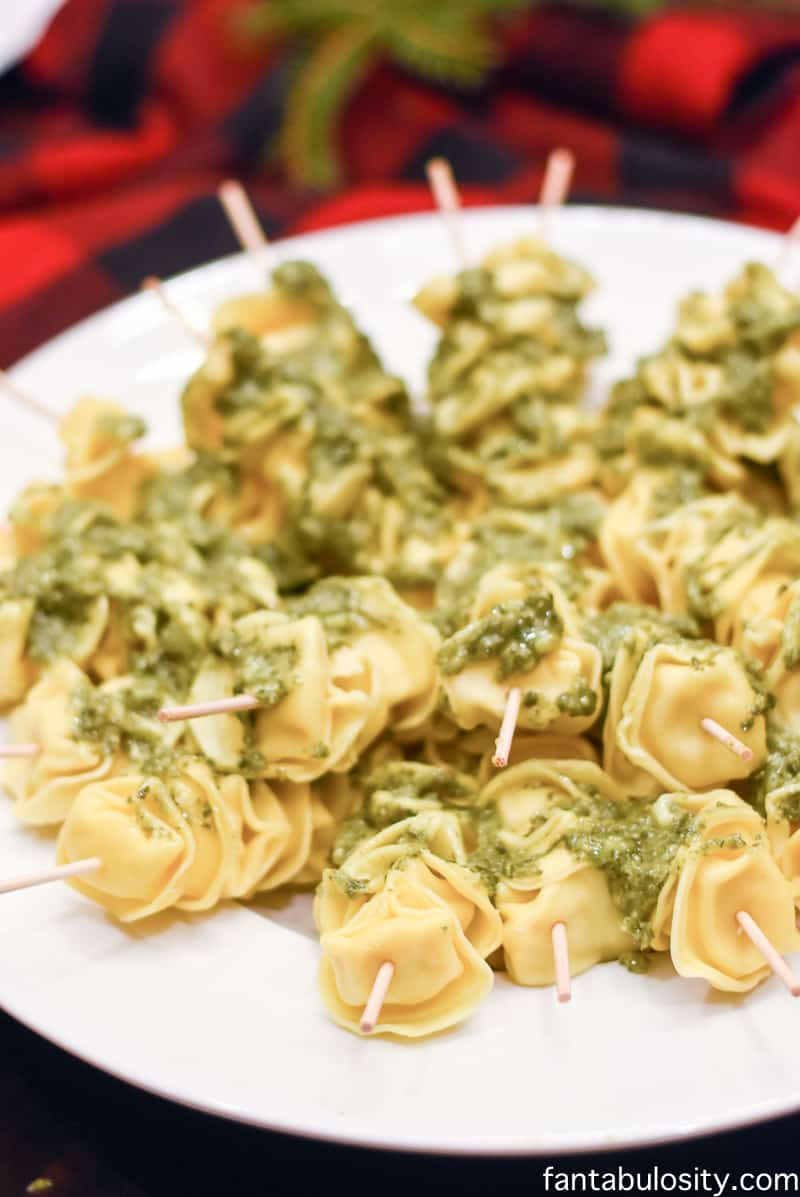 Cheese tortellini skewers with pesto. Perfect appetizer for cocktail party. Favorite Things Party Ideas - How to Host Favorite Things Party fantabulosity.com