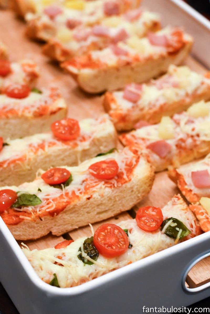 French Bread Pizzas for cocktail party style. Finger foods for Favorite Things Party Ideas - How to Host Favorite Things Party fantabulosity.com