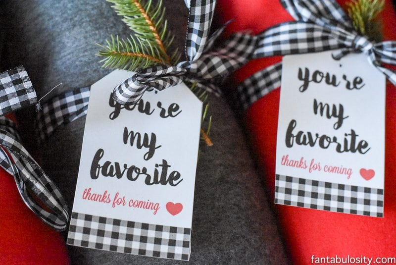 Fleece Blankets with ribbon and spruce sprigs and tags. Favorite Things Party Ideas - How to Host Favorite Things Party Favors