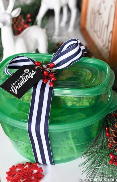 Spicy saltine crackers in a green gift wrapped tub