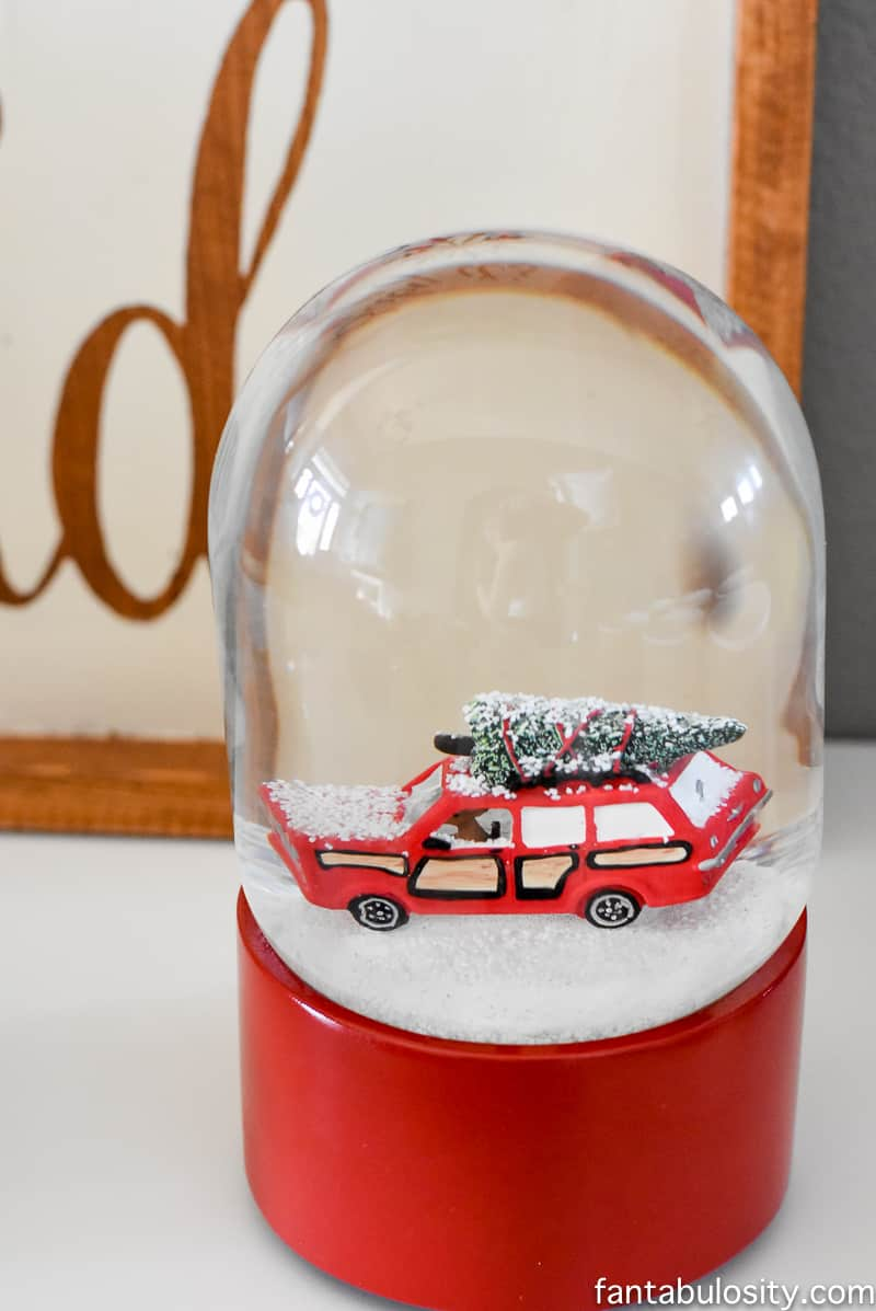 EEEK, this SNOW GLOBE! Vintage Christmas Party Ideas: Truck with Christmas Tree, cupcakes, red green and white, hot chocolate bar