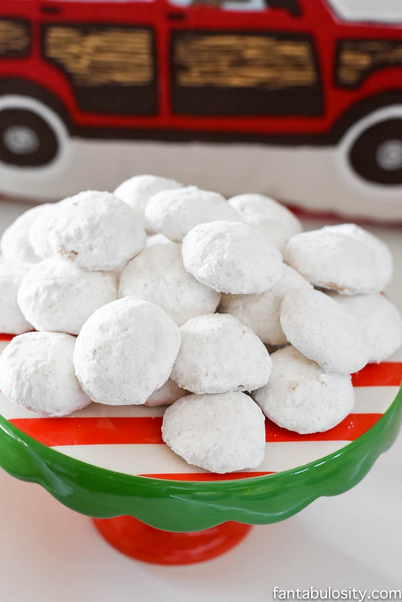 Snowball cookies for a party! Vintage Christmas Party Ideas: Truck with Christmas Tree, cupcakes, red green and white, hot chocolate bar