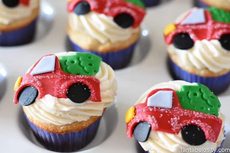 OMG! These cupcakes are ADORABLE! Vintage truck and tree for a party! Vintage Christmas Party Ideas: Truck with Christmas Tree, cupcakes, red green and white, hot chocolate bar
