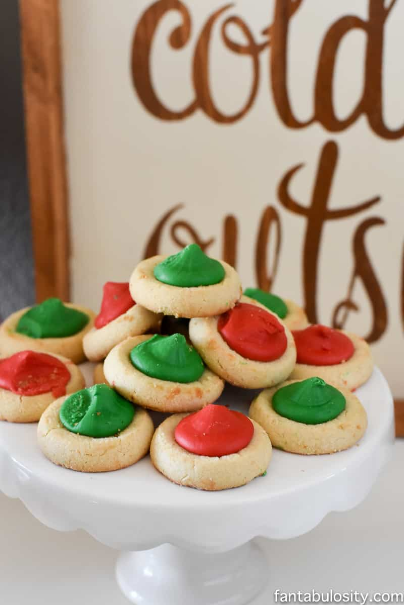 Red and green thumbprint cookies for a party! Vintage Christmas Party Ideas: Truck with Christmas Tree, cupcakes, red green and white, hot chocolate bar