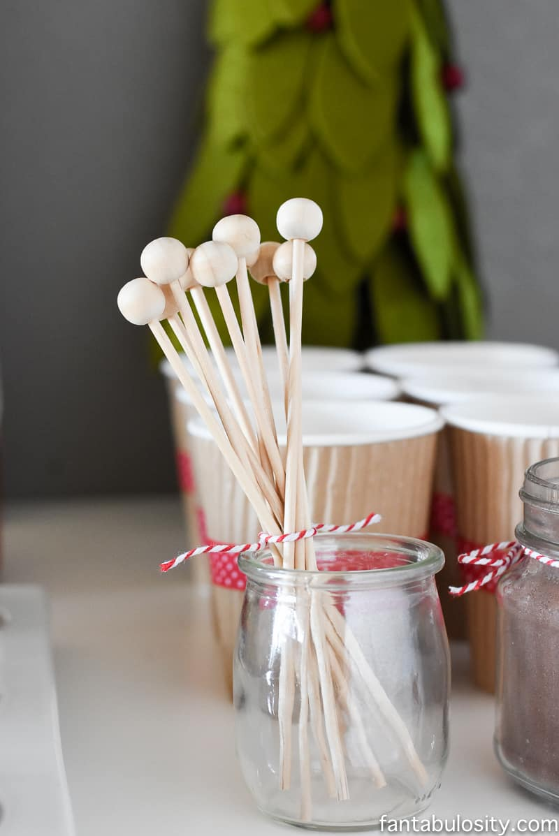Such a cute idea! Love these drink stirrers. Hot chocolate station on a dessert table! Vintage Christmas Party Ideas: Truck with Christmas Tree, cupcakes, red green and white, hot chocolate bar