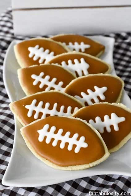 Football cookies DIY! So cute, and doable!!! Perfect for a football party. Football party ideas fantabulosity.com