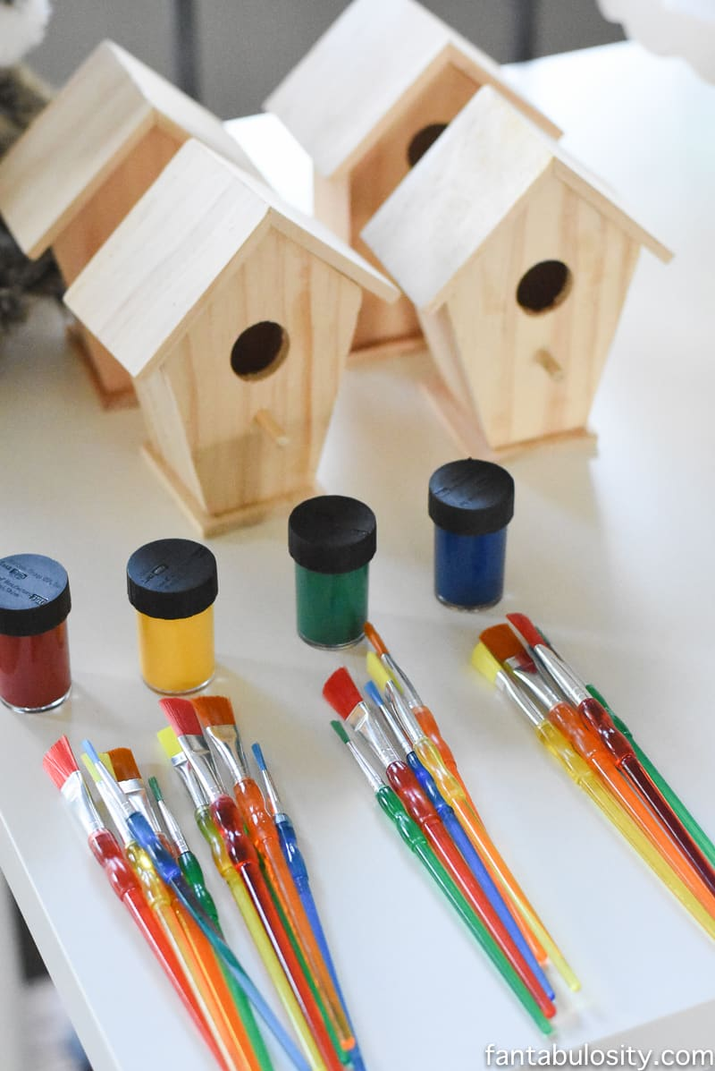 A Camp-In Sleepover! Birdhouse painting activity for a Camping Sleepover Birthday Party! How fun is this! It's all so cute!!! Camping Sleepover Birthday Party Ideas! Pottery Barn Kids, fake fire, tents, sleeping bags, fire birthday cake, kaleidoscope, birthday banner.