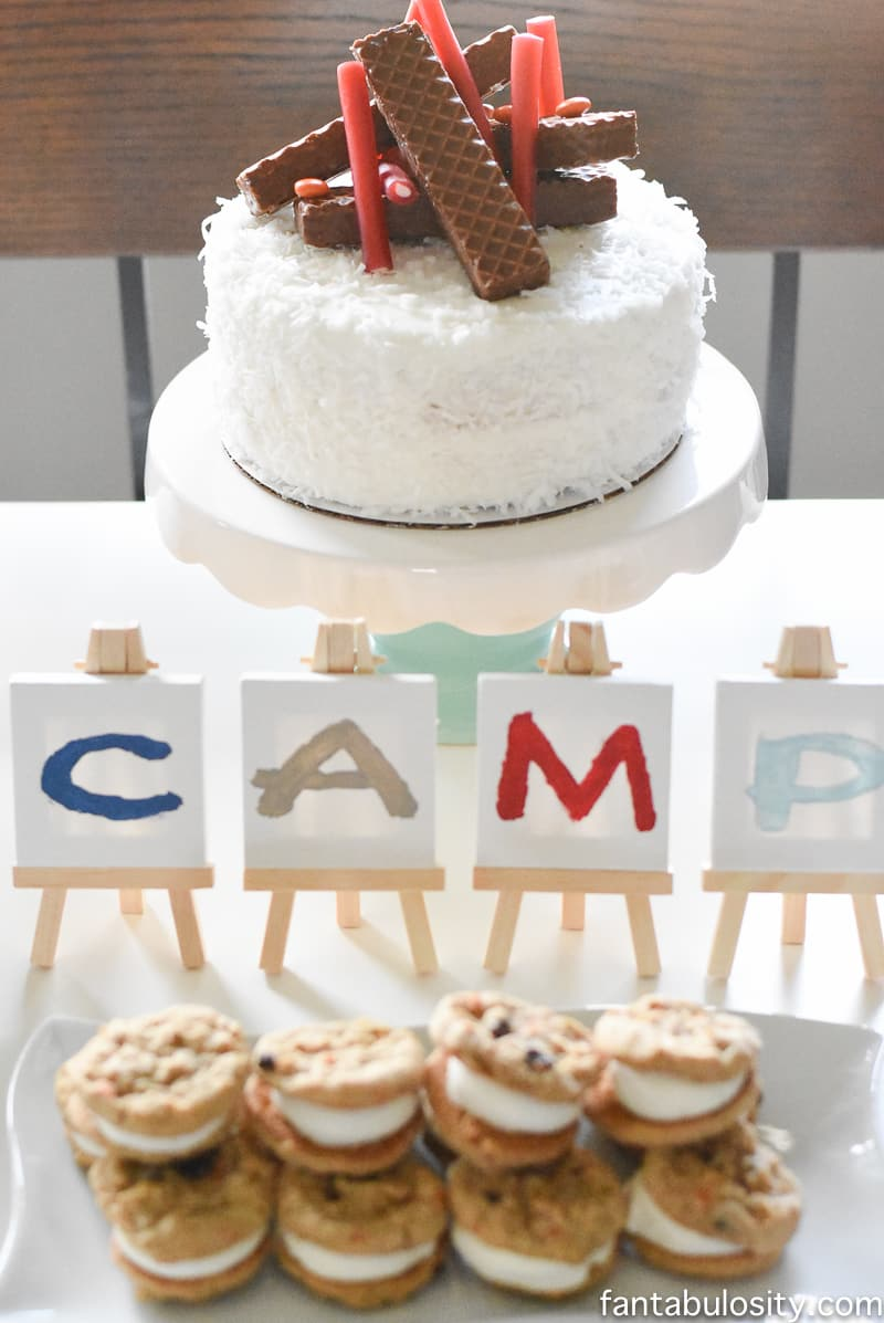 "A Camp-In Sleepover! ""CAMP,"" mini painted easels. Camping birthday cake. How fun is this! It's all so cute!!! Camping Sleepover Birthday Party Ideas! Pottery Barn Kids, fake fire, tents, sleeping bags, fire birthday cake, kaleidoscope, birthday banner."