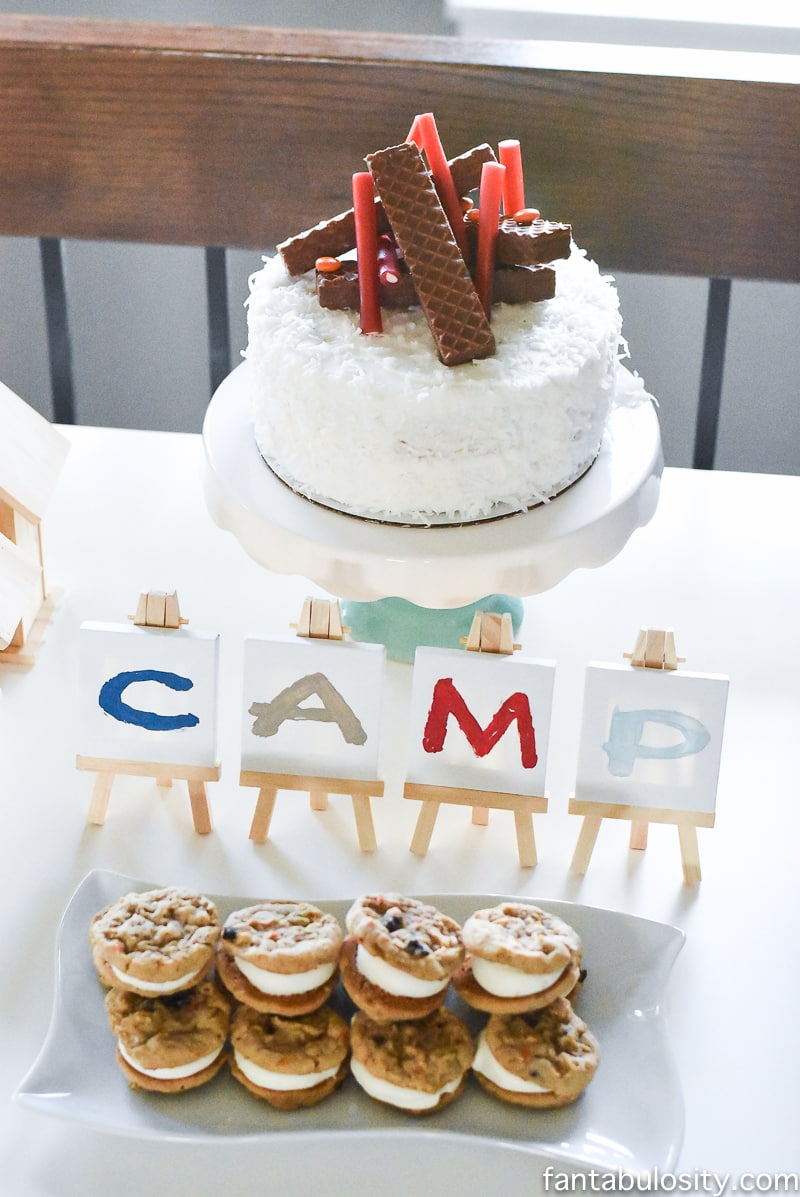 A Camp-In Sleepover! Camping birthday cake with fire. How fun is this! It's all so cute!!! Camping Sleepover Birthday Party Ideas! Pottery Barn Kids, fake fire, tents, sleeping bags, fire birthday cake, kaleidoscope, birthday banner.
