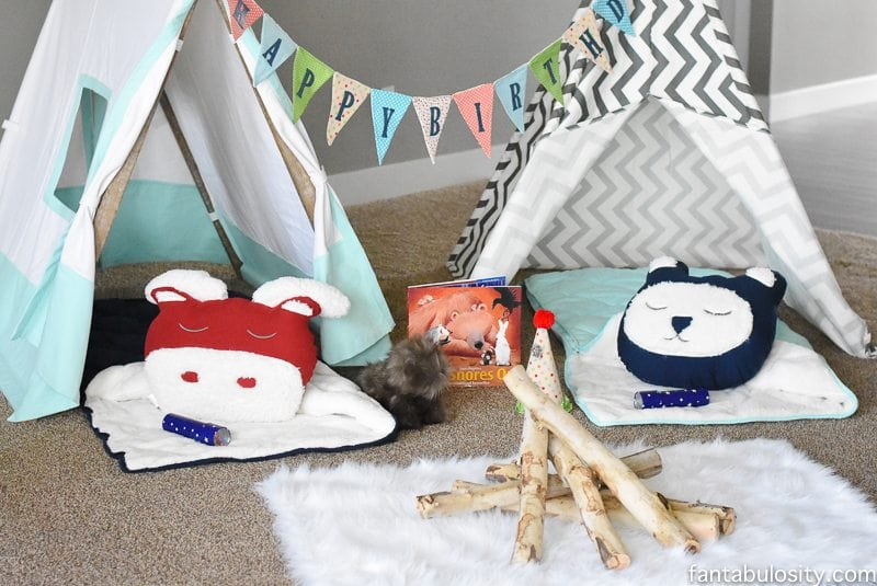 A Camping Sleepover Birthday Party! How fun is this! It's all so cute!!! Camping Sleepover Birthday Party Ideas! Pottery Barn Kids, fake fire, tents, sleeping bags, fire birthday cake, kaleidoscope, birthday banner.
