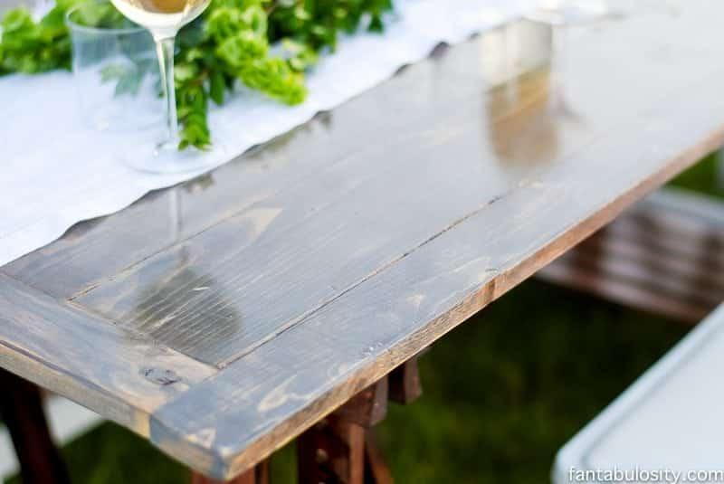 Two sawhorses from IKEA, with a table top and it's an instant pop up table! Love this. Pop Up Backyard Dinner Party: Entertaining Ideas, classy, easy simple, quick, fun, outside. Outdoor Party Ideas