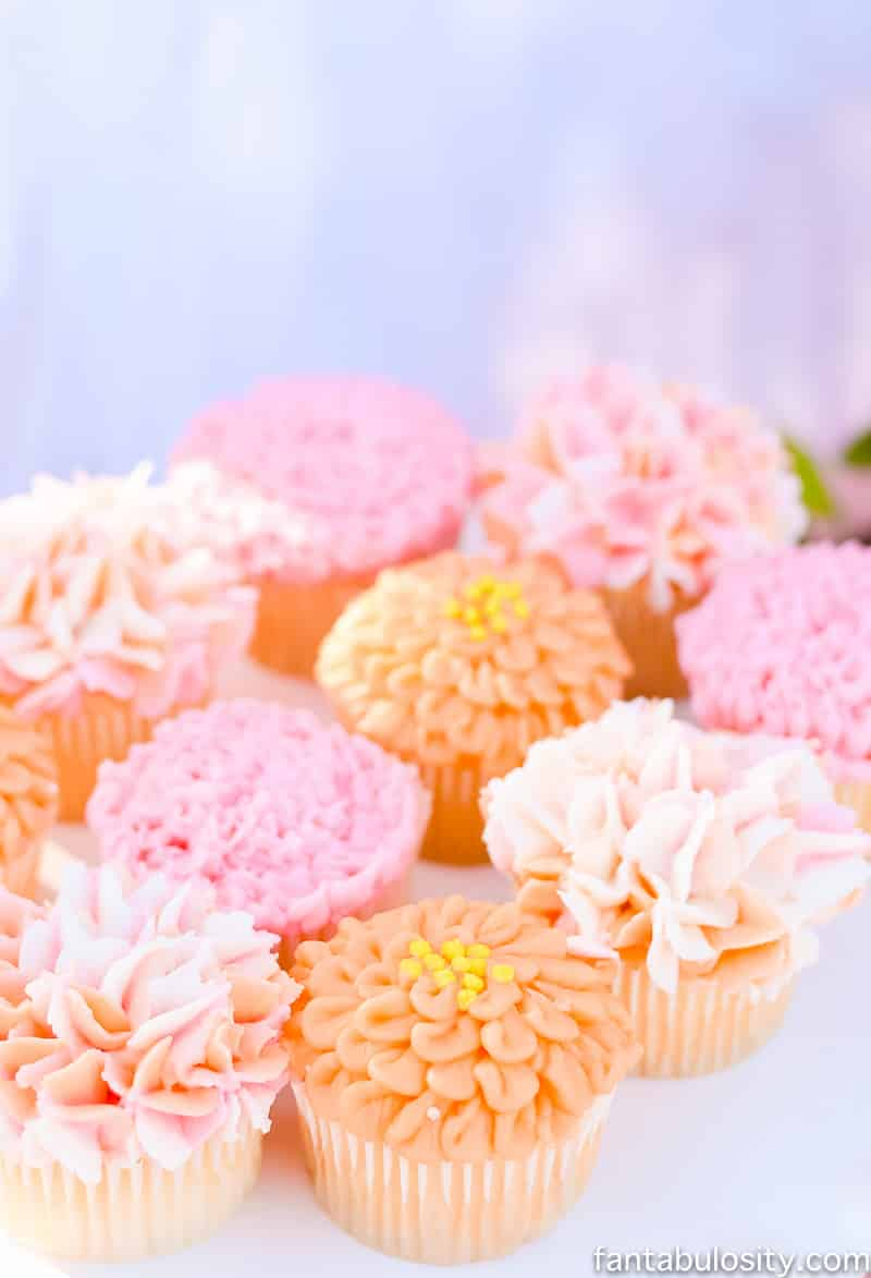 "Flower cupcakes; carnation & hydrangea pinks, peaches, coral ""Favorite Things"" Party"