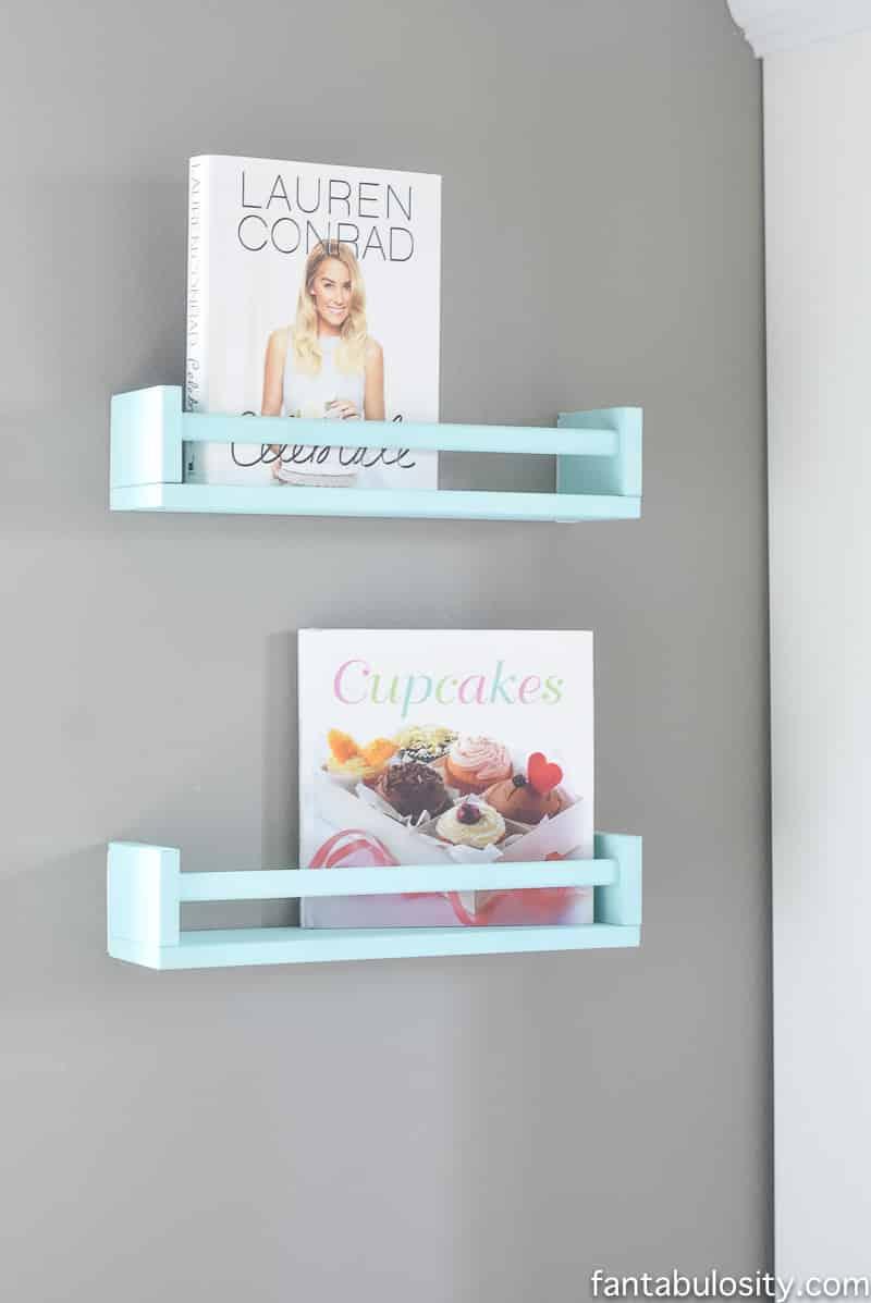 IKEA spice racks turned in to bookshelves. Ahhh! So cute.