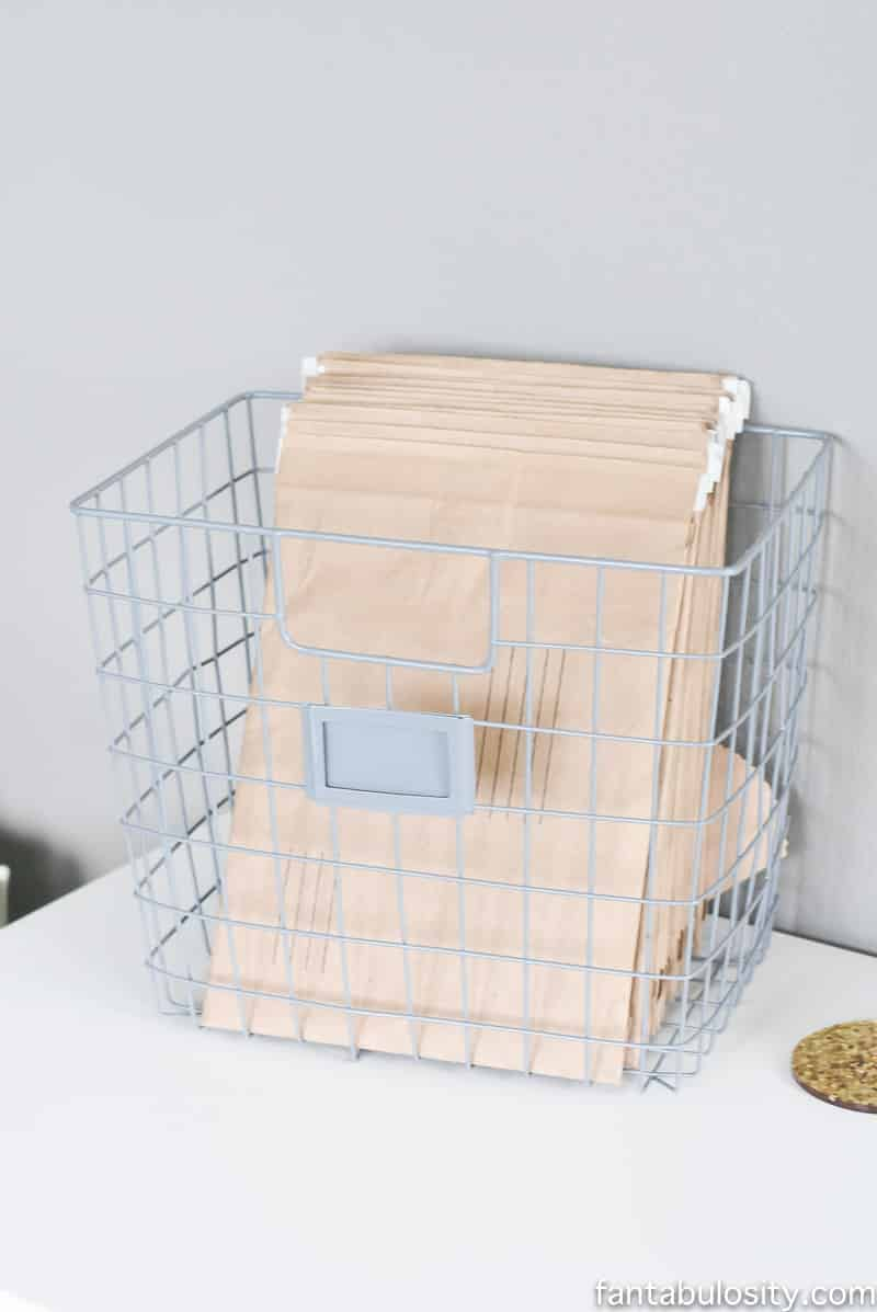 Wire basket to hold envelopes on desk for shipping products