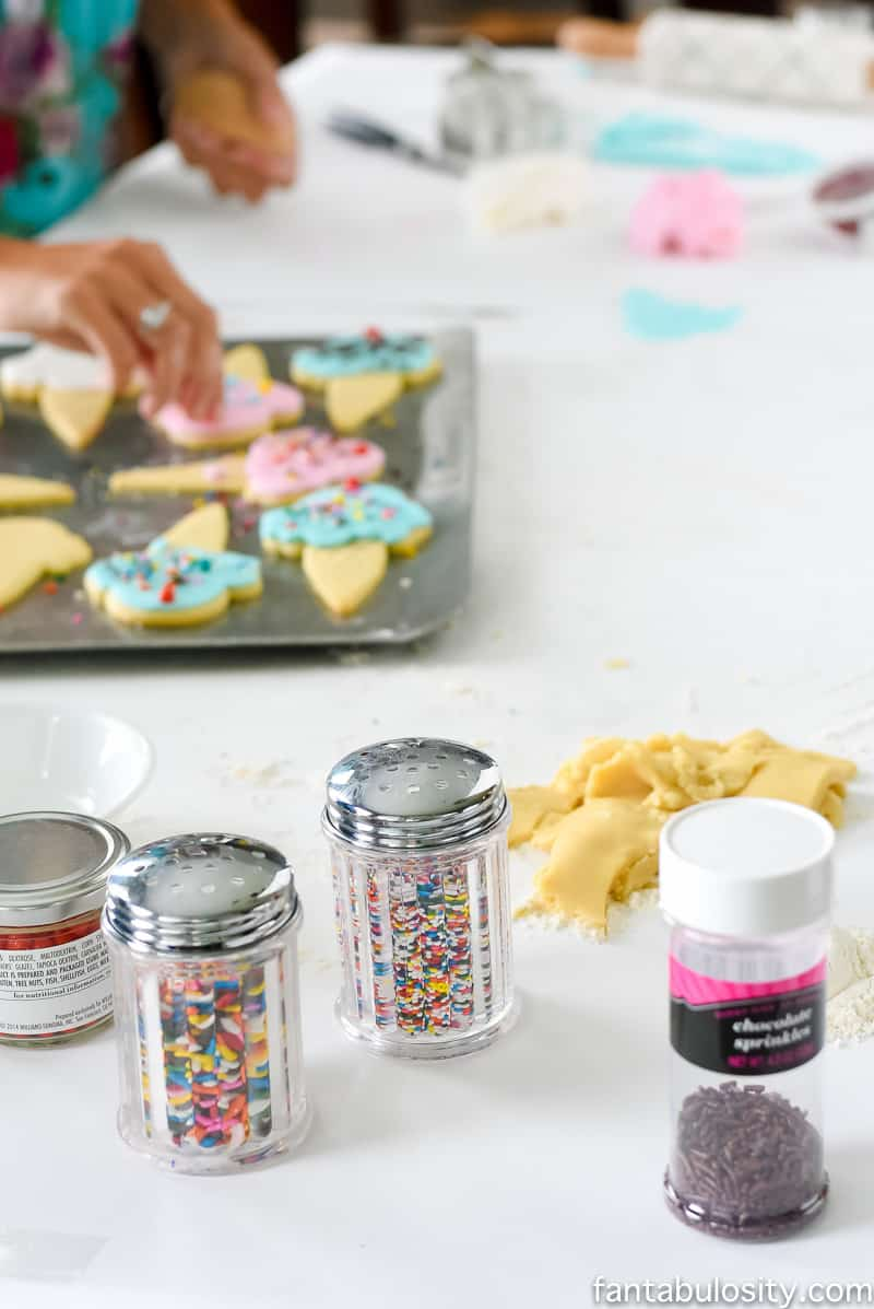 Decorating sugar cookies, with fondant instead of icing! So so cute!