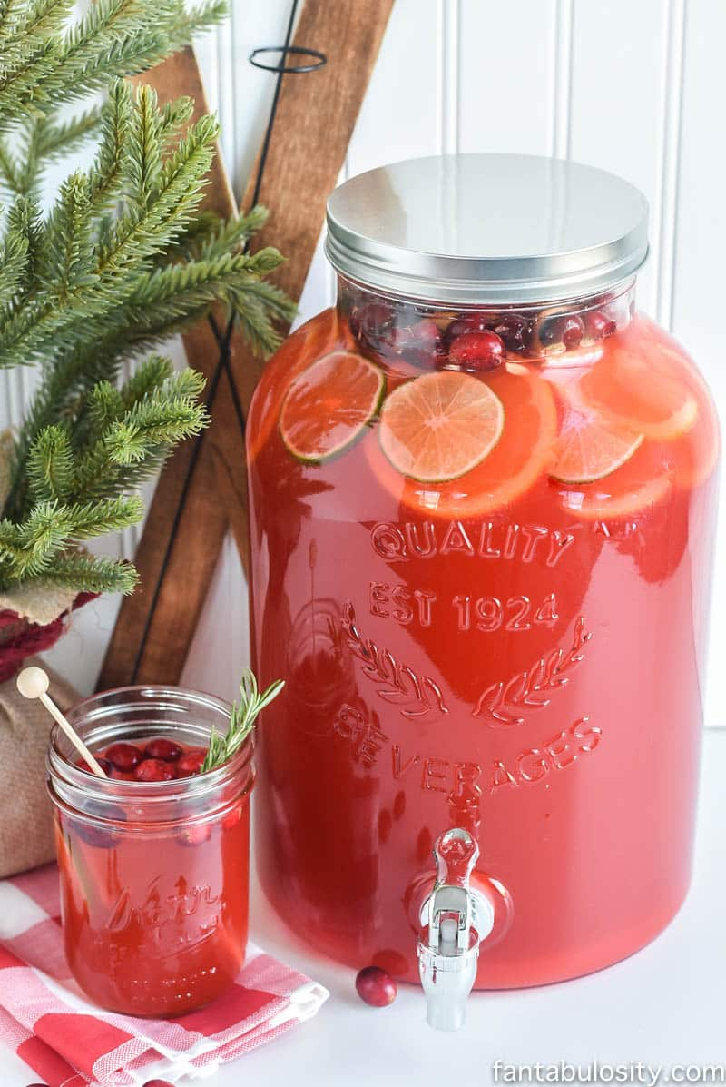 Fruit punch in drink dispenser and mason jar