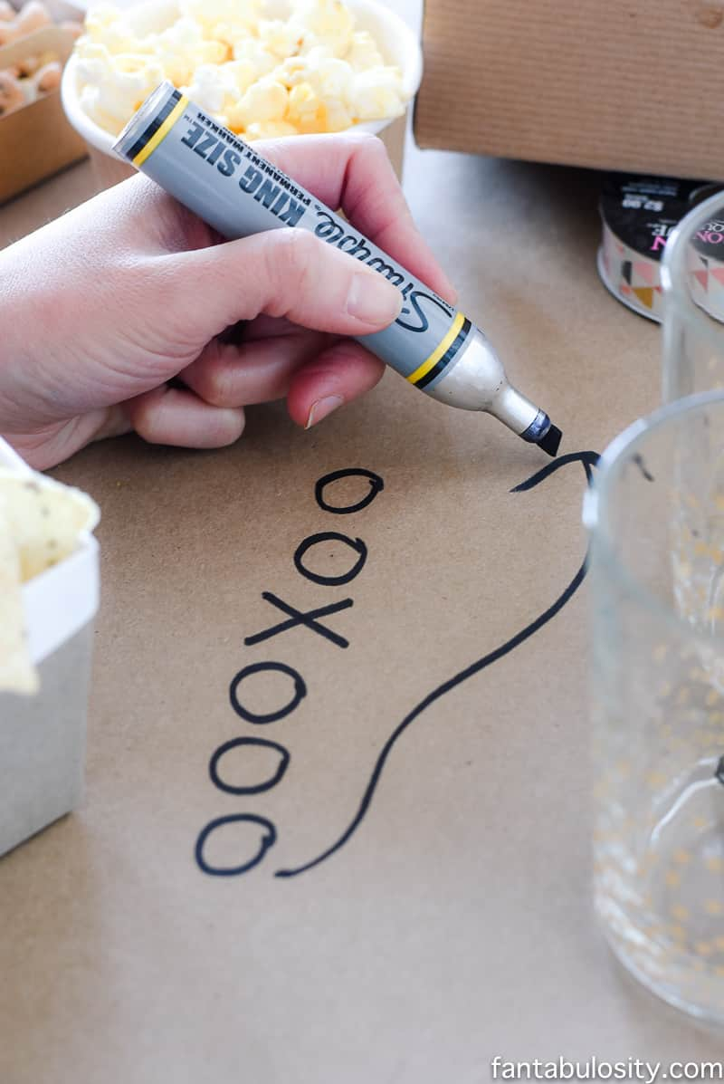 Football party ideas: Craft paper table runner with football plays drawn on. So easy.