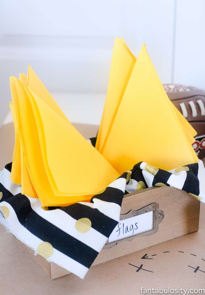 """Yellow napkins for """"flags,"""" at a football party"""