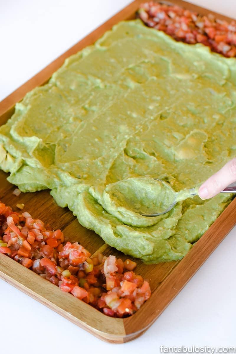 Football Party Food: Field made of guacamole and pico de gallo, then a football shaped dip! So fun!