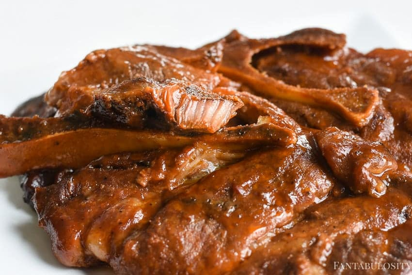 BBQ Pork steaks in the slow cooker are SO much easier than grilling, and they come out so tender!