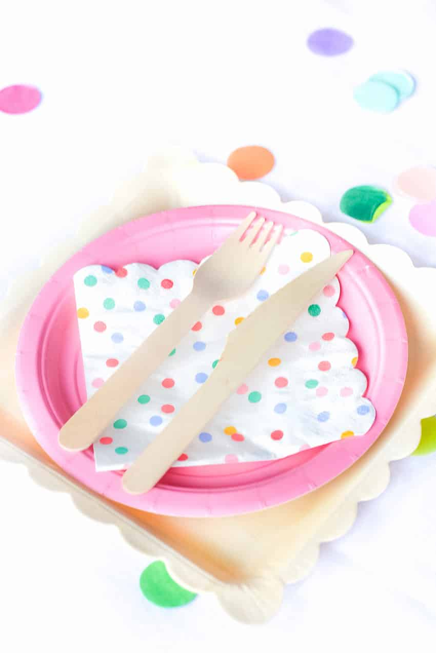 What an adorable place setting with wooden utensils for Fiesta Theme Party: A confetti and pastel fiesta party!