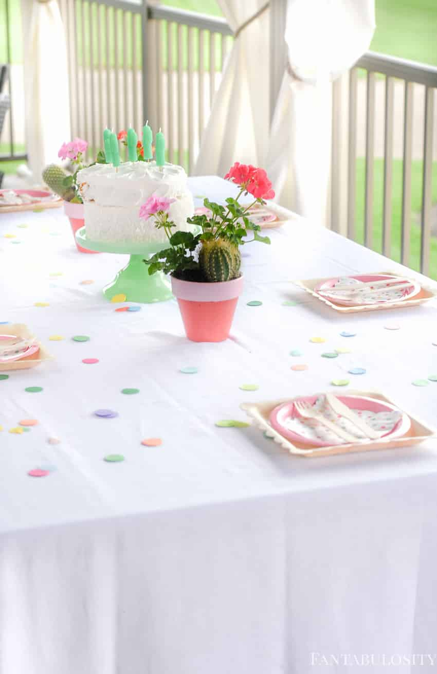 Place setting and tablescape for Fiesta Theme Party: A confetti and pastel fiesta party!