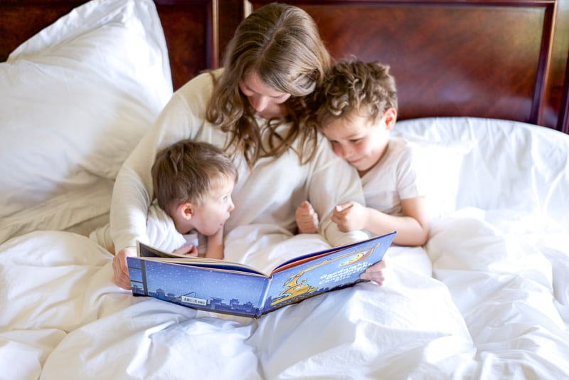 mom reading to little boys