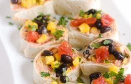 Taco-Pinwheels are SOO easy to make and serve at parties. Cream cheese, taco seasoning, corn, black beans, RO*TEL...MMM! !Plus they're no-bake/no-cook! Even better!