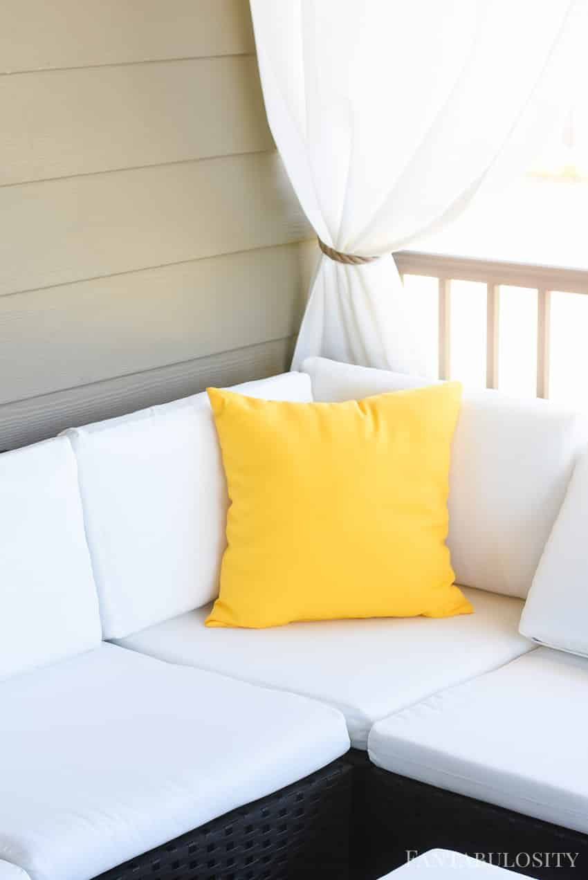 Craftsman Home Patio. Yellow outdoor pillows for a white sectional sofa