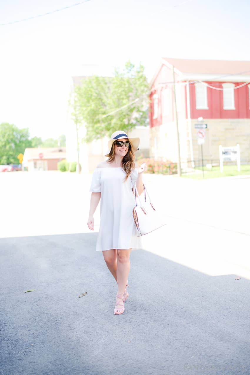 A classy look for the season. White off the shoulder shift dress; perfect for spring and summer day or night!