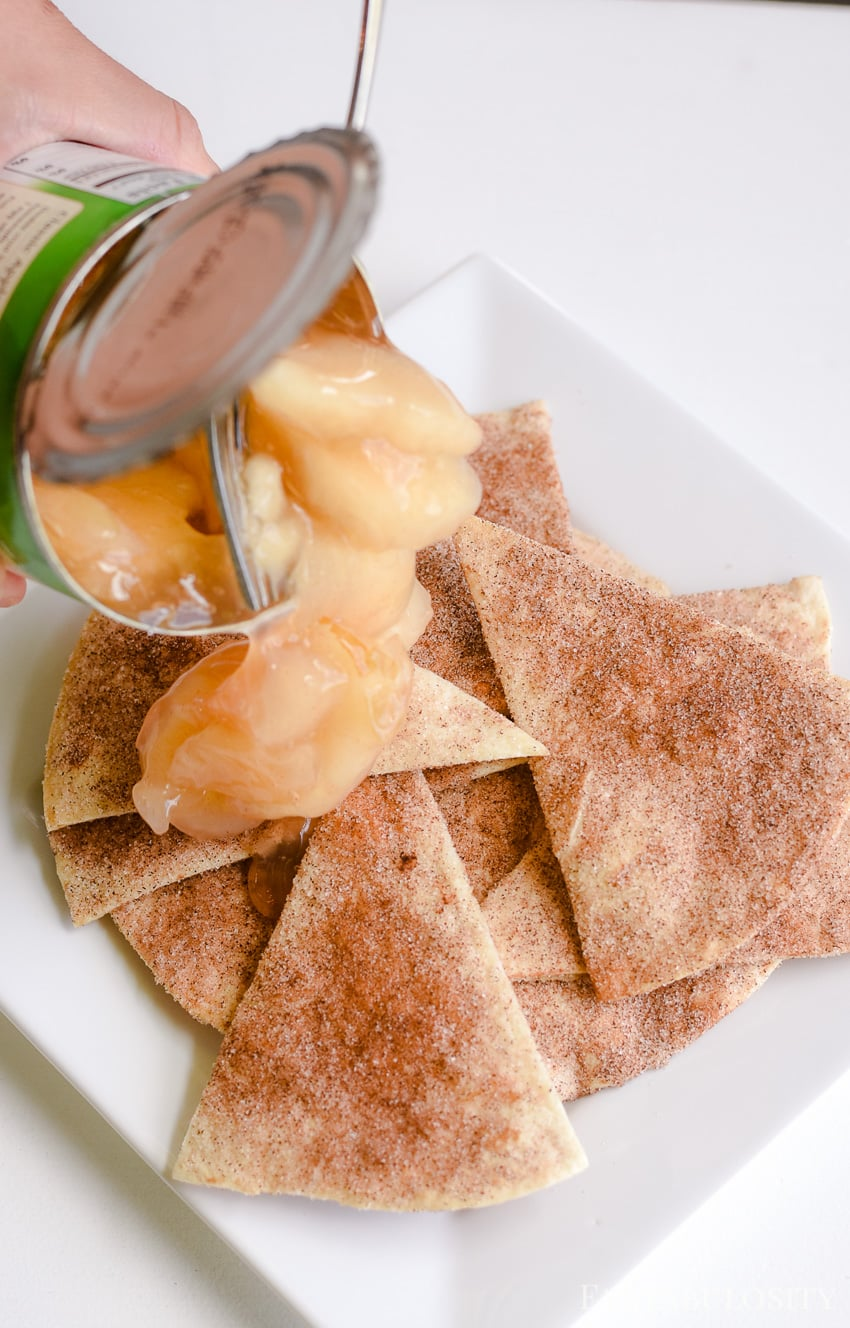 Using canned pie filling, top the baked cinnamon sugar tortillas
