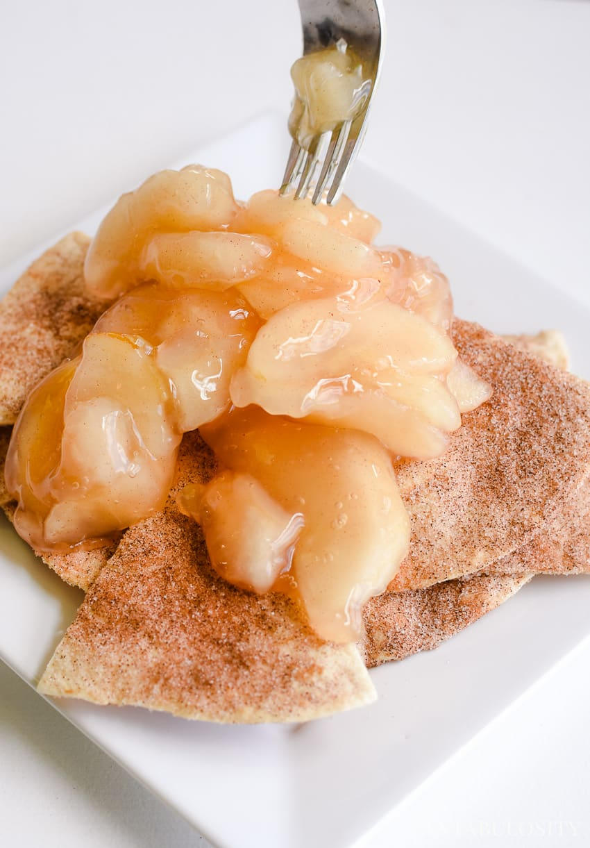 Canned apple pie filling on top of baked cinnamon and sugar tortilla triangles - easy dessert idea when you don't want to make a whole pie