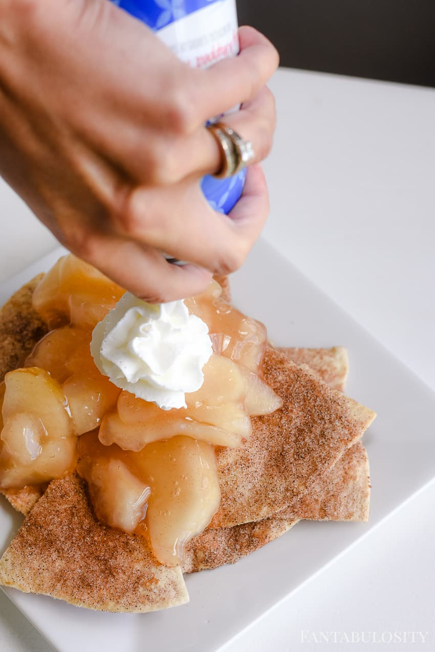 Top the apple pie nachos with whipped cream for a yummy quick dessert idea
