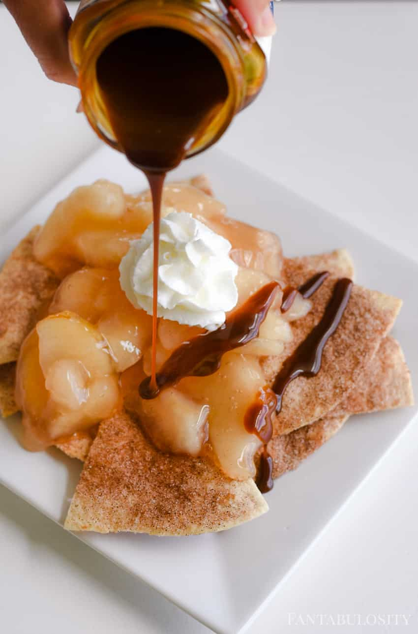Using chocolate syrup or caramel drizzle, top the apple pie nachos for a delicious quick and easy dessert idea