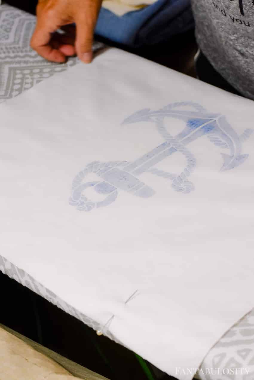 How to make a pillow cover then stencil a design on it.