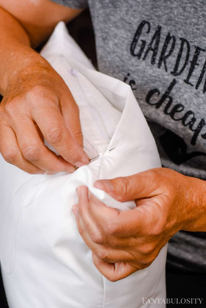 Hand sew the top of the pillow cover for a clean look.