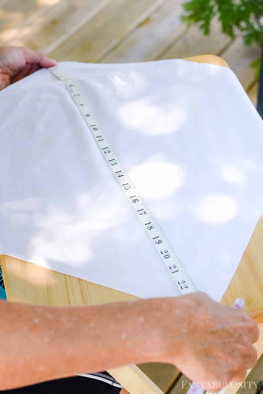 Measure to the center of the pillow cover to know where to center the stencil