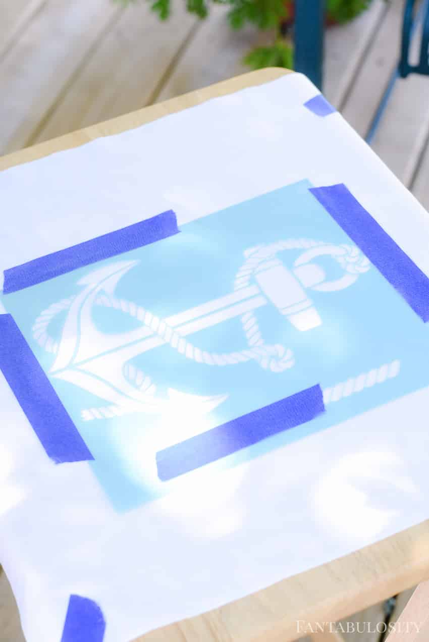 Using painters tape, tape the stencil (if it's not adhesive especially) to hold in place. Using Martha Stewart anchor stencil