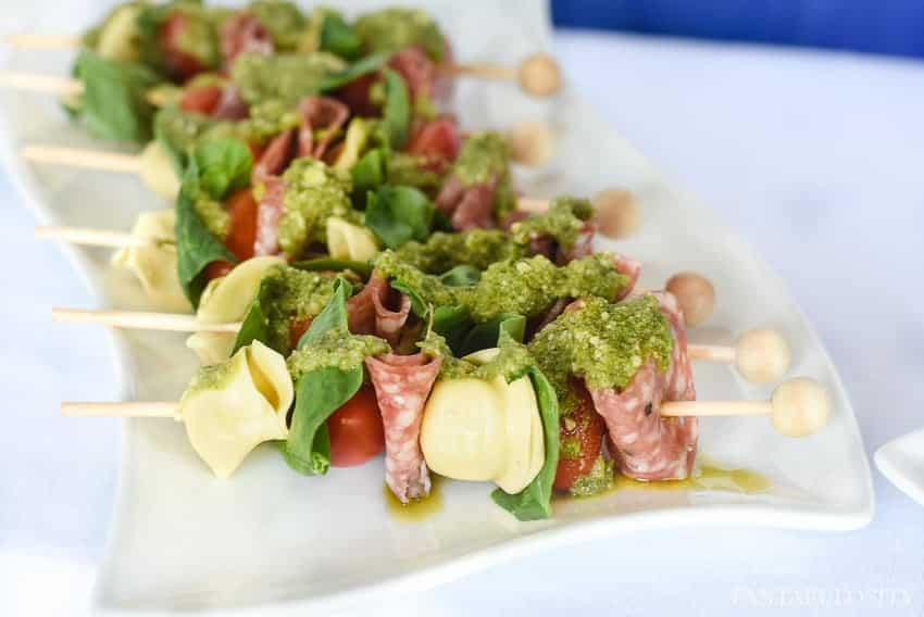 Mmm! And so easy. Salami, tortellini, veggies and pesto! Perfect appetizer idea for a summer soiree!
