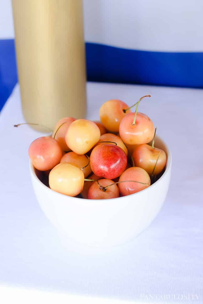 A bowl of cherries for a tablescape at an outdoor party. Such a cute and easy idea!