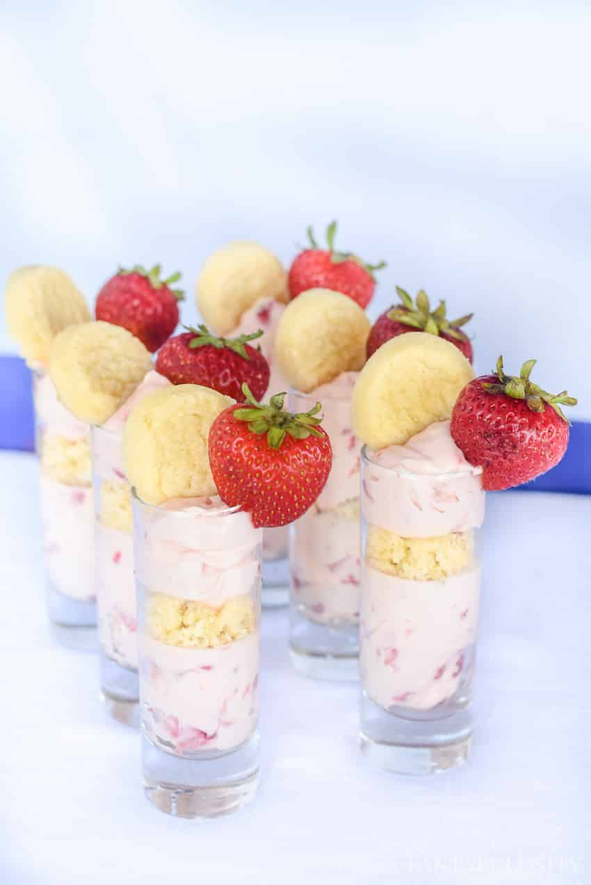 Mmm! Strawberry cheesecake and sugar cookie dessert trifles! These mini little treats are a no bake dessert idea for a party!