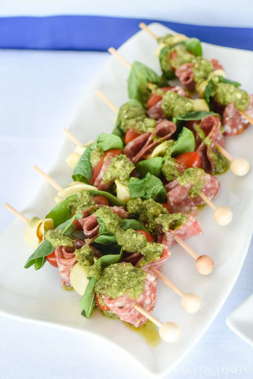What!!!? So easy and she used drink stirrers to make a super cute skewer! Salami & tortellini kabobs.