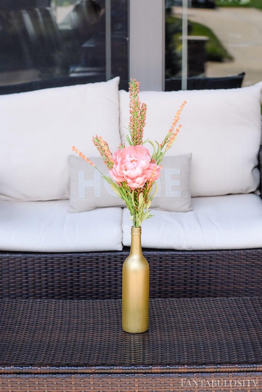 Gold vase for flowers for summer soiree