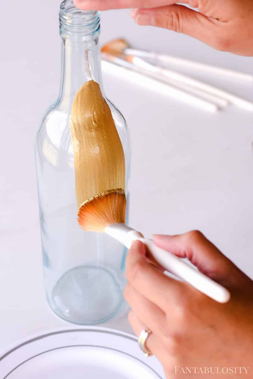 Painting a wine bottle to make a vase for party decor - wine bottle crafts